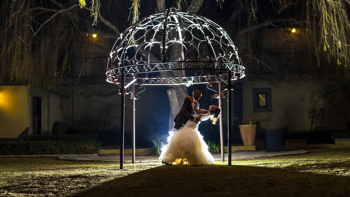 Wedding gallery - and groom under canopy